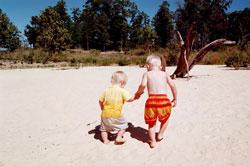 Toddlers walking in sand at Norfork Lake