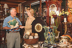 man and woman in antique shop