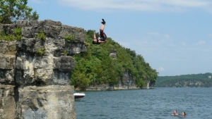 Boy jumps off bluff at Norfork lake