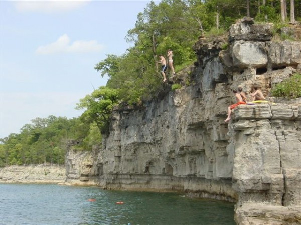 Boys cliff jumping on Norfork Lake