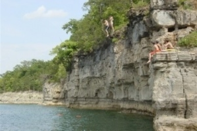 Boys jump from bluff at lake