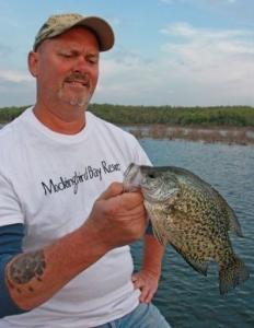 Man hold crappie fish Norfork Lake