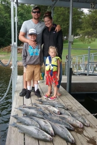 Family with large stringer of stripers