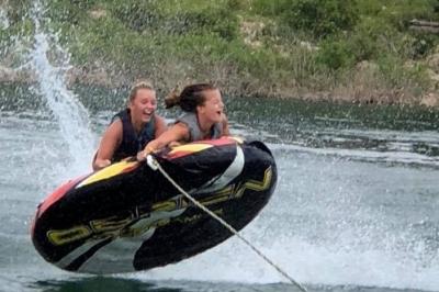 Girls tubing on Norfork Lake