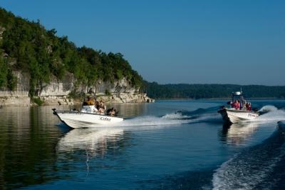 Boats near bluffs on lake