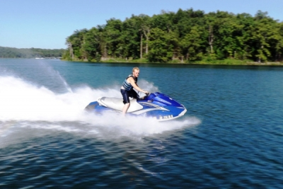 Teen jet skis on Norfork Lake