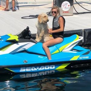 Girl and dog on jet ski