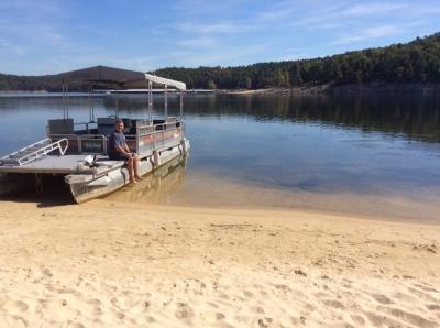 Pontoon boat beached at Sand Island