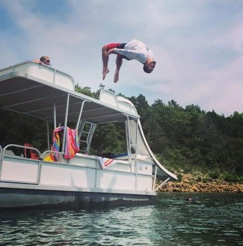 Teen flips off pontoon boat.