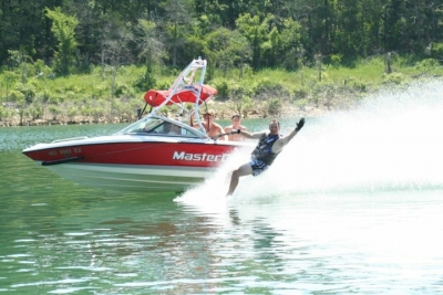 Boat and water skier on lake