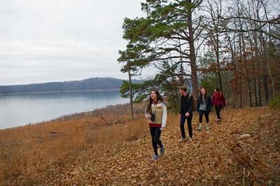 Family hiking along Norfork Lake shore