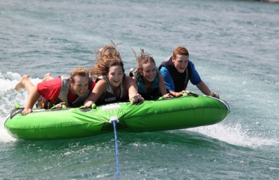 Teens tubing on Norfork Lake