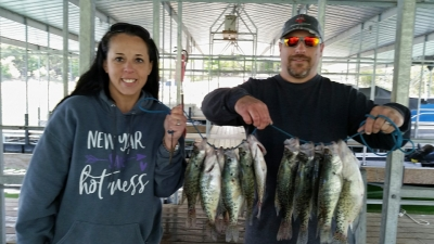 Man and woman with large stringer of crappie.